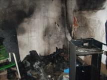 Los Bomberos sofocan un incendio en una vivienda en la Calle Zapatería